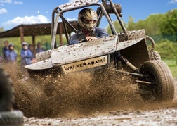 A man from a stag party racing A WA Rebel Dirt Buggy