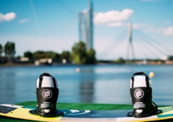 Wakeboarding with Riga backdrop