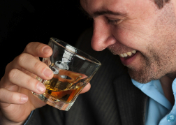 Man drinking a dram of whiskey