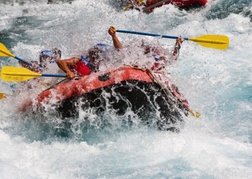 White water rafting hitting frothing water