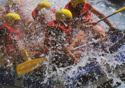 group get hit White water rafting by water spray on their weekend