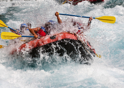 White water rafting hitting huge frothy water