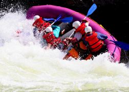 White water rafting tipping over