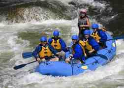 stag party White Water Rafting in a blue raft