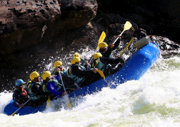 White water rafting hitting frothy water