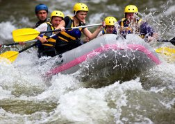 White water rafting hitting choppy water