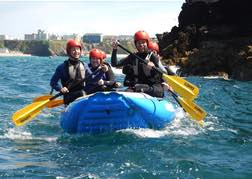 a group White Water Sea Rafting on their stag weekend in Newquay