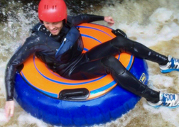 A man White Water Tubing Cardiff