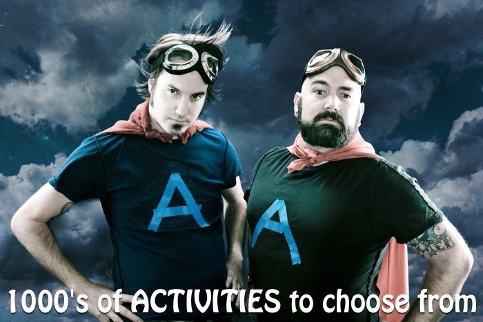 Stag and his best man dressed up as super heros with text 1000s of activities to choose from