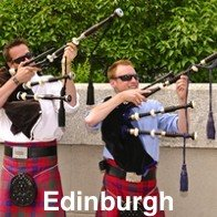 2 Bag Pipers holding up their pipes, funny