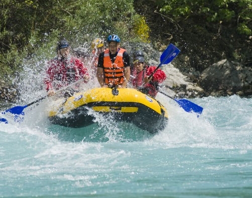 Group an a yellow raft doing white water rafting