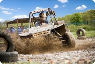 A Rebel Buggy or Dirt Buggy kicking up dirt