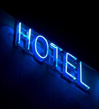 Hotel Sign in Blue Neon Lights
