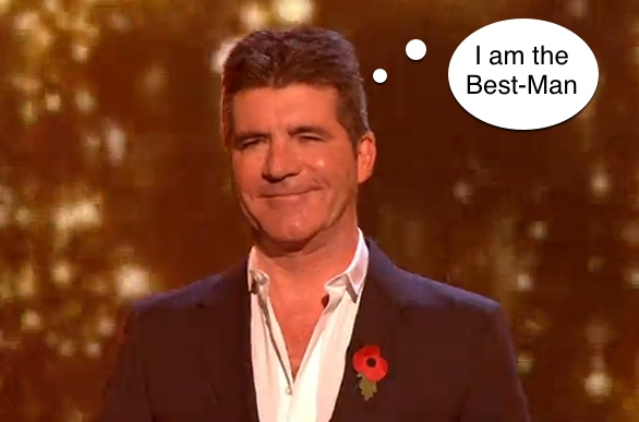 Simon Cowell on the X Factor Stage stating thinking bubble saying I am the best man