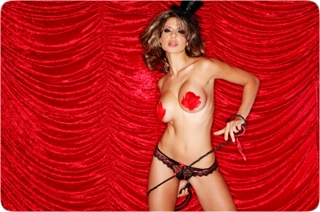 Lap Dancer with Tassels in front of a red curtain
